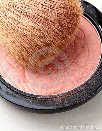 Pink compact blush with brush