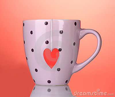 Pink cup and tea bag with red heart-shaped
