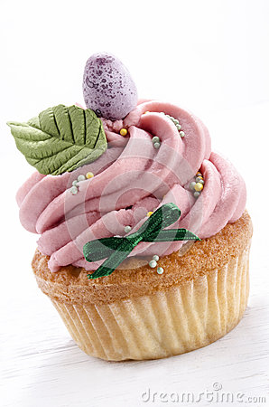 Pink cupcake with easter egg and leaf