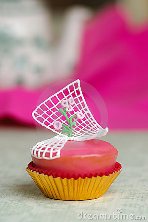 Pink cupcake with roses