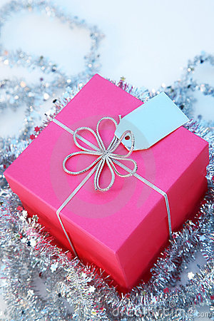 Pink Gift box with a silver ribbon and tag