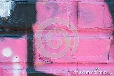 Pink Graffiti Art Covers Brick Wall