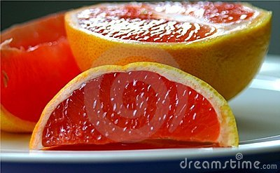 Pink Grapefruit slices on plate