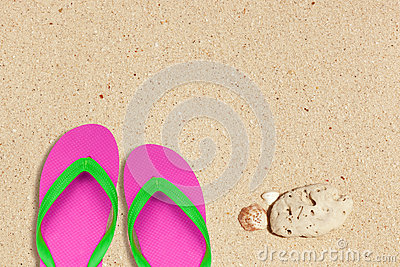 Pink and green flip flops on the beach