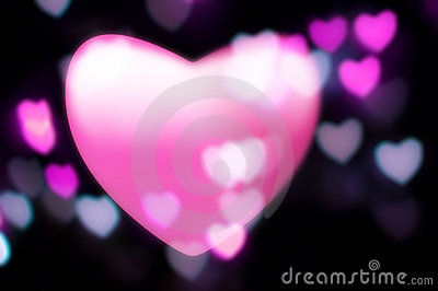 Pink heart blurs into out-of-focus lights