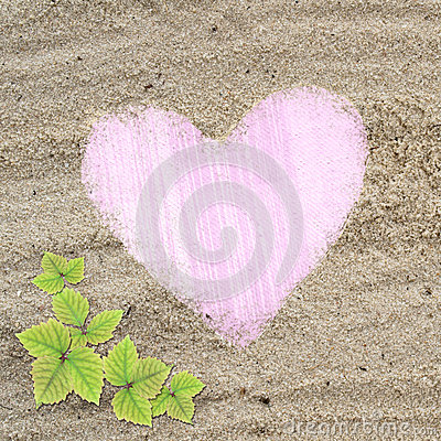 Pink heart shape frame in sand beach texture