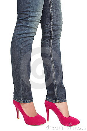 Pink high heels and jeans - woman legs