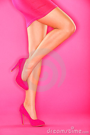 Pink high heels shoes on pink