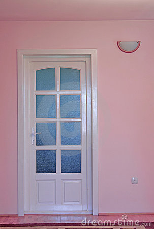 Pink home interior with door