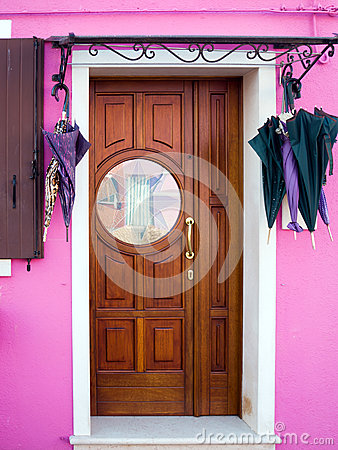 Pink house door with stained glass