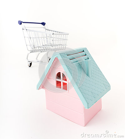 Pink house and shopping trolley