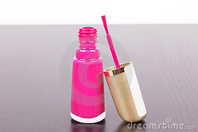 Pink lacquer with stick on table