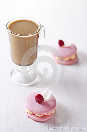 Pink macaron and cup of coffee