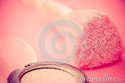Pink makeup brush and eyeshadow
