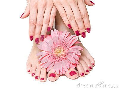 Pink manicure and pedicure with a flower