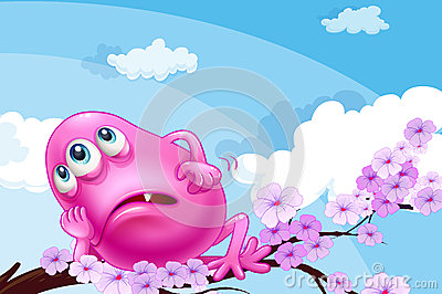 A pink monster resting at a branch of a tree