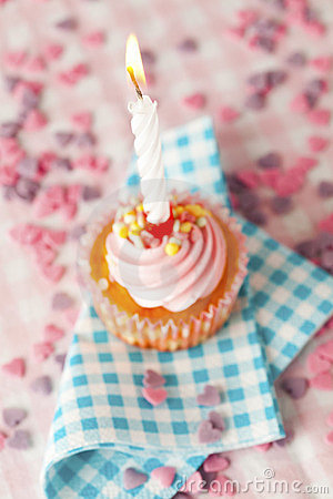 Pink muffin with candle