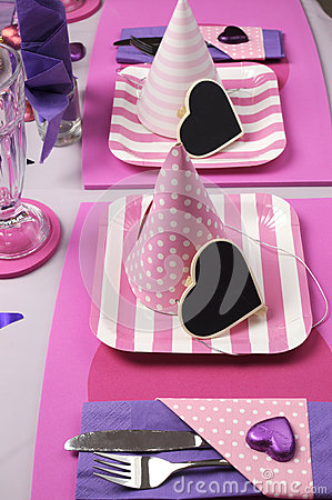 Pink party hats on table setting vertical royalty free for Dots and stripes party theme