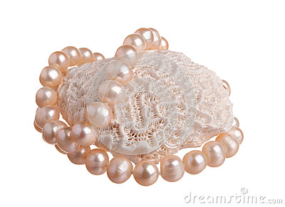 Pink pearl nacklace on a big coral