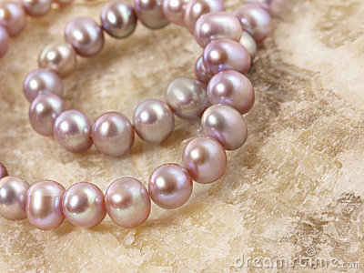 Pink pearls on a stone