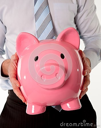 Pink piggy bank with businessman in the background