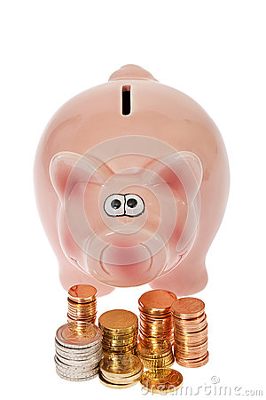 Pink piggy bank and euro coins