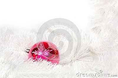 Pink retro ball and Christmas tinsel