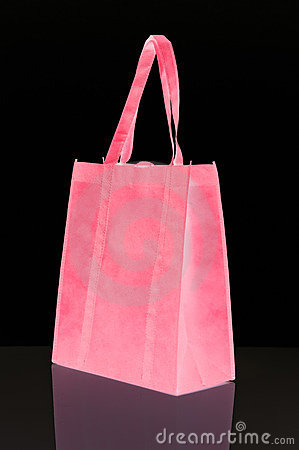 Pink reusable shopping bag isolated