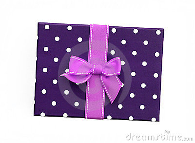 pink ribbon gift bow on purple gift box