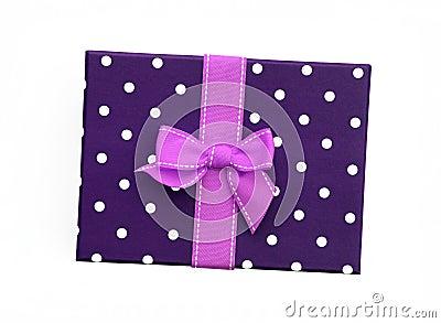 pink ribbon gift bow on purple gift box