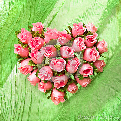 Pink rose heart on the green cloth