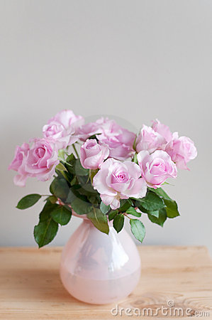 Pink roses on gray wall
