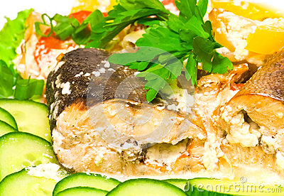 Pink salmon baked with vegetables and greens