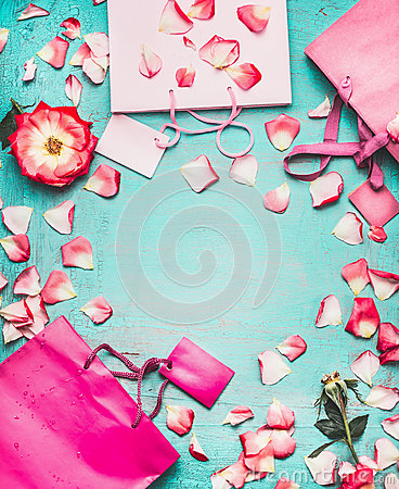 Free Pink Shopping Bags , Flowers And Blank Tags On Turquoise Background, Top View Royalty Free Stock Photos - 82221898
