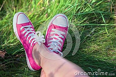 Pink sneakers on girl legs