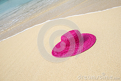 Pink Straw Hat on a Beach 2