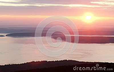 Pink sunrise in mountain and sea shore