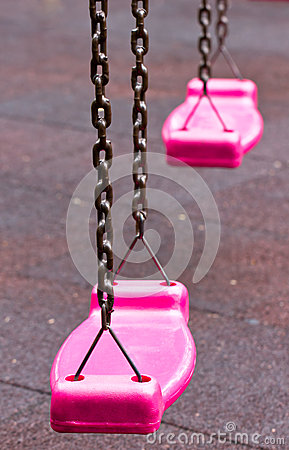 Pink Swing In Playground.
