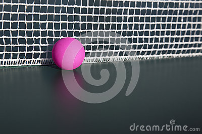 Pink table tennis ball in the net