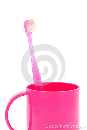 Pink toothbrush and cup
