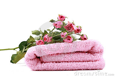 pink towel and small roses royalty free stock image