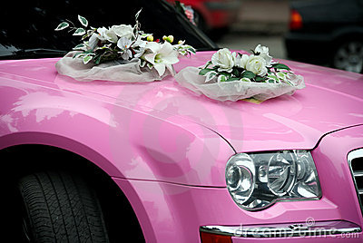Pink wedding car with a bouquet of flowers