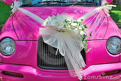Pink wedding car with bouquet of flowers