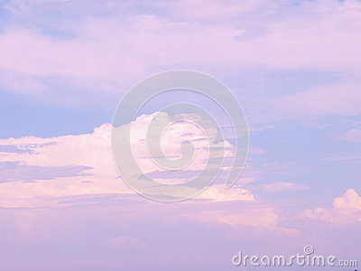 Pink and white clouds in blue sky