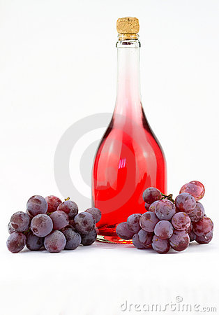 Pink wine and grapes