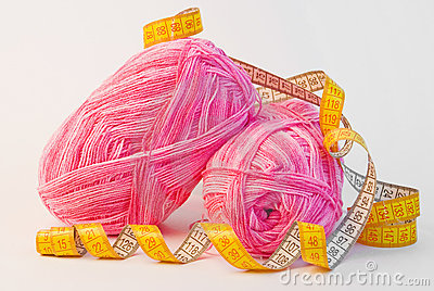 Pink yarn balls with measuring tape