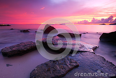 Pinky sunset & the rock at the coast