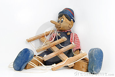 Pinocchio sitting on white