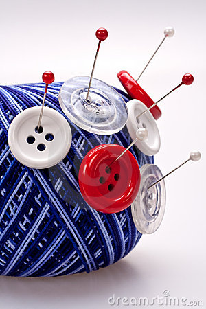 Pins in wool ball with buttons