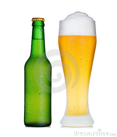 Pint glass of beer and bottle in dew